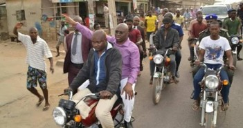 Governor Fayose rides Okada as he inspects water fetching points in a community in Ekiti